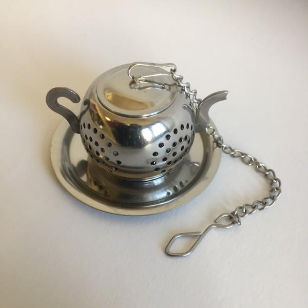 Boule à thé en forme de théière avec son support